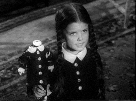"Wednesday Addams and her headless doll named ""Marie Antoinette"""